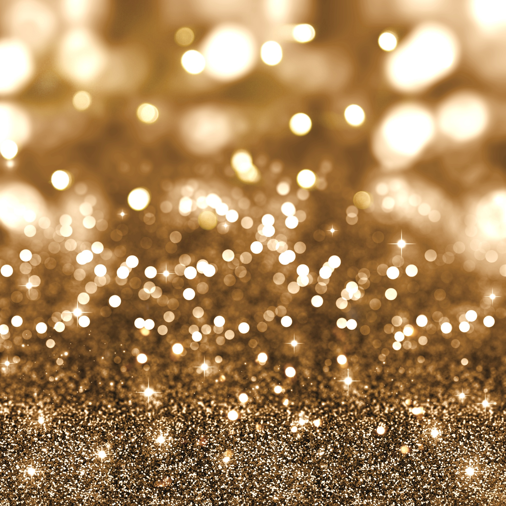 Golden christmas glitter background with stars and bokeh lights
