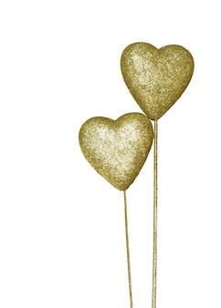 白い背景にある金色の装飾の心