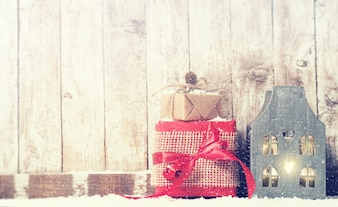 Golden gift on red gift on a wooden background