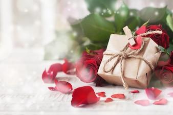 Golden gift resting on roses