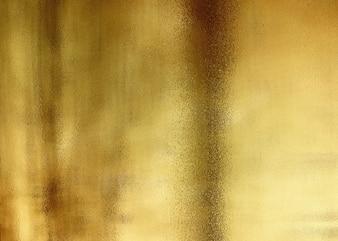 金色の光沢のある抽象的な金属のテクスチャ背景