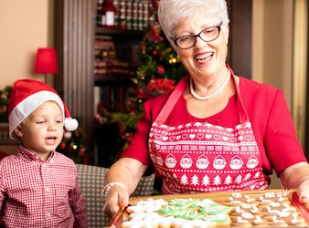 Grandmother holding a tray with christmas cookies