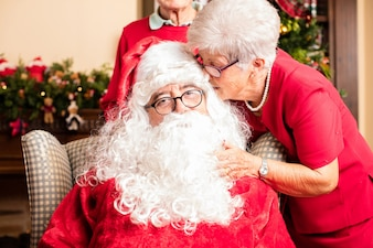 Grandmother talking to santa claus on christmas