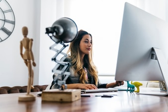 Graphic designer sitting at desk