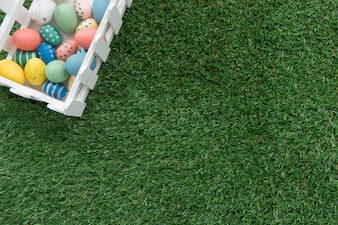 Grass background with fence in a corner for easter day