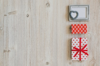 Gray frame and polka dot gifts on a wooden table
