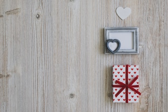 Gray frame with two gifts and a white heart
