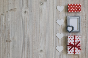 Gray frame with two gifts and white hearts