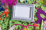 Gray photo frame with confetti and colorful glasses