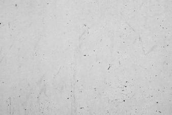 Gray wall with dark spots