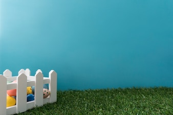 Great composition with wooden fence and colored eggs