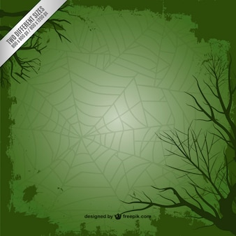 Green background with spider web for Halloween