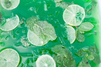 Green drink with sliced lime and mint with iced, Close up
