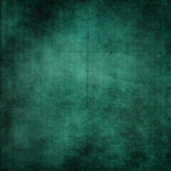 折り目と折り目の付いた緑のグランジ紙の背景