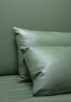 Green leather pillow on the sofa