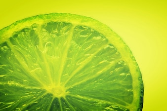 Green lemon in a yellow background