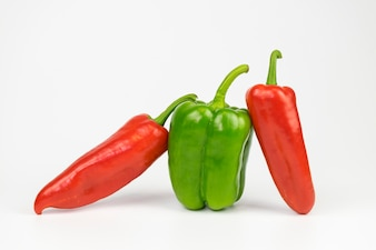 Green pepper between red peppers