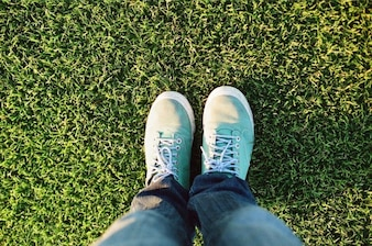 Green sneakers on the grass