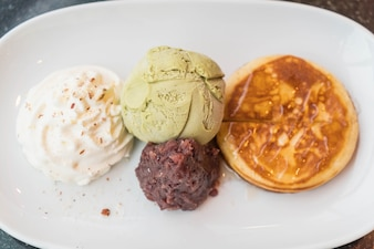 Green tea ice-cream with pancake ,red bean and whipping cream