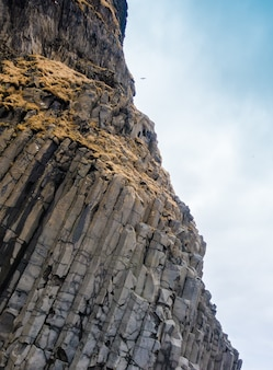Grey basalt columns near Reynisdrangar beach, Iceland .