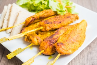 Grilled meat barbecue on a wooden stick