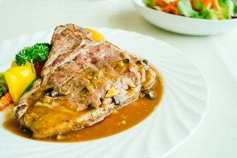 Grilled t-bone beef meat steak with vegetable