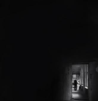 Groom and bride in dark building