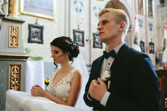 Groom and bride in the church