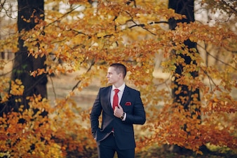 Groom with tree background