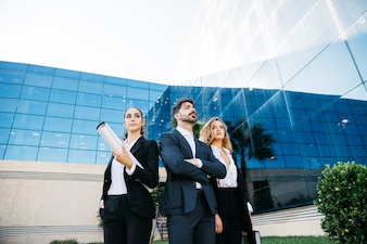 Group of architects in front of modern building
