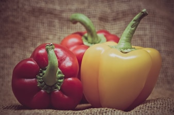 Group of bell peppers on rustic burlap background