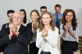 Group of business people clapping