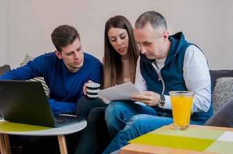 Group of friends working on their small business at home. Team of successful business people having a meeting. Smiling business people working at home