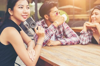 Group of young hipster sitting in a cafe,Young cheerful friends