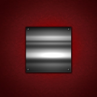 Grunge metal background with a shiny metallic plate on a red leather texture