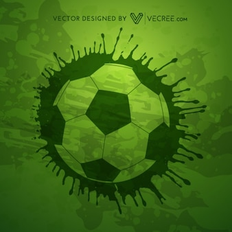Grunge soccer ball on green background