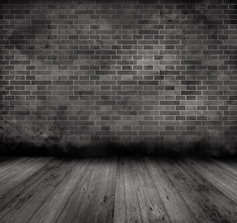 Grunge style image of an old interior with brick wall and wooden floor