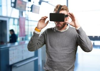 Guy enjoying with virtual reality glasses
