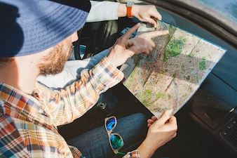 Guy in car with map