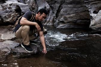 Guy touching water