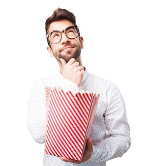 Guy with popcorn thinking about the film