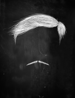 Hair and thin mustache on blackboard