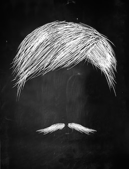 Hair and thin mustache sketch on blackboard