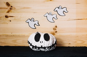 Halloween pumpkin with ghost shaped decorations