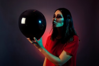 Halloween woman trying to kiss balloon