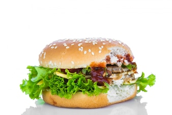 Hamburger with cheese, lettuce and tomatoes