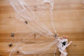 Hand in cobweb