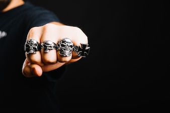 Hand in decorative silver rings