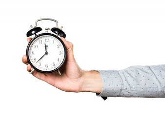 Hand of man holding vintage clock