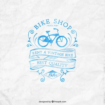Hand painted bike shop logo